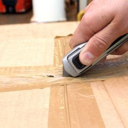 AutoSafe Pro heavy duty utility knife being used as a box cutter